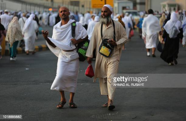 Muslim pilgrims walk in a street in Saudi Arabia's holy city of Mecca on August 18 ahead of the start of the annual Hajj pilgrimage The sixday Hajj...