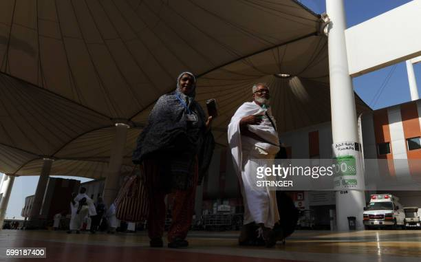 Muslim pilgrims walk outside the King Abdul Aziz airport upon their arrival to the Red Sea port city of Jeddah on September 4 2016 Muslim pilgrims...