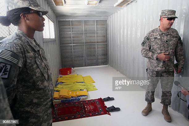 A Muslim prayer mat a mattress yellow prison uniforms and a washing bowl are shown in a holding cell in Camp Bucca on the outskirts of the southern...