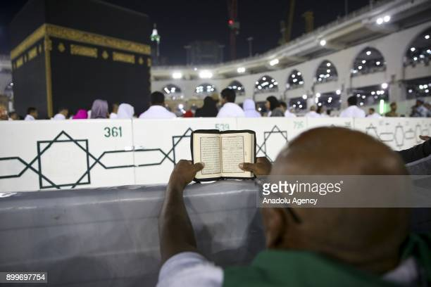 A muslim prays at Masjid alHaram located in Islam's holiest city of Mecca and home to the Kabaa as they perform Umrah in Mecca Saudi Arabia on...