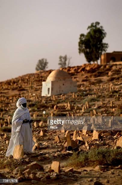 Muslim prays in the cemetery April 2000 in Ghadames Libya