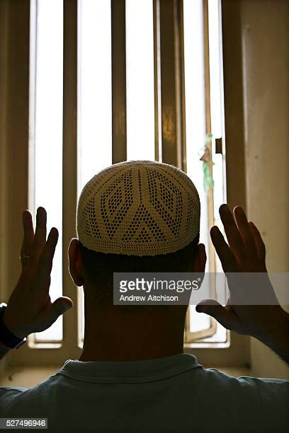 A Muslim prisoner prays in his cell at Wandsworth prison HMP Wandsworth in South West London was built in 1851 and is one of the largest prisons in...