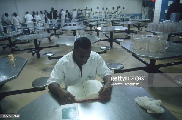A muslim prisoners studies the koran in the lunch room at the Ferguson Unit a Texas State Prison on January 15 1997 in Midway Texas
