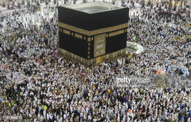 Muslim prospective Hajj pilgrims circumambulate the Kaaba at Masjid alHaram in Mecca Saudi Arabia on August 12 2019 on the second day of Eid AlAdha...