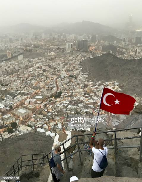 Muslim prospective pilgrim carries Turkish flag as the pilgrims climb the Jabal alNour to visit Hira Cave during the annual Hajj pilgrimage in Mecca...