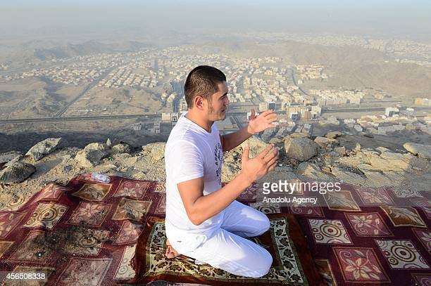 Muslim prospective pilgrim prays at the top of Jabal Thawr housing a cave known as Ghar alThawr where the Islamic Prophet Muhammad and his companion...