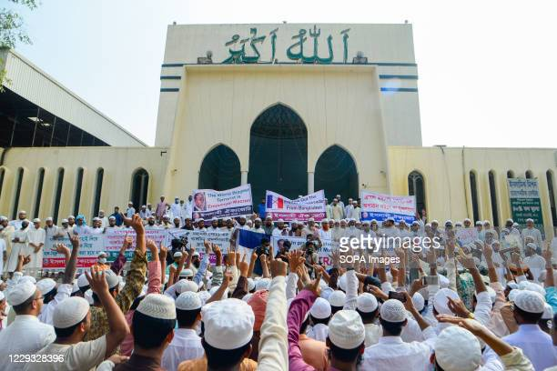 Muslim protesters chant slogans, display placards and banners during the protest against French president Emmanuel Macron in Dhaka. Thousands of...