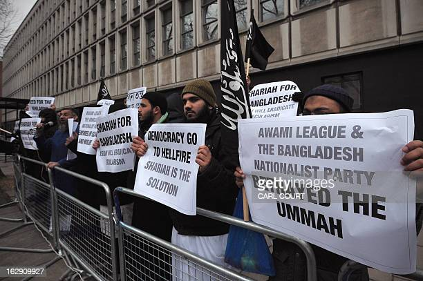 Muslim protesters hold signs against the Bangladeshi government as they protest outside the embassy of Bangladesh in central London on March 1 a day...