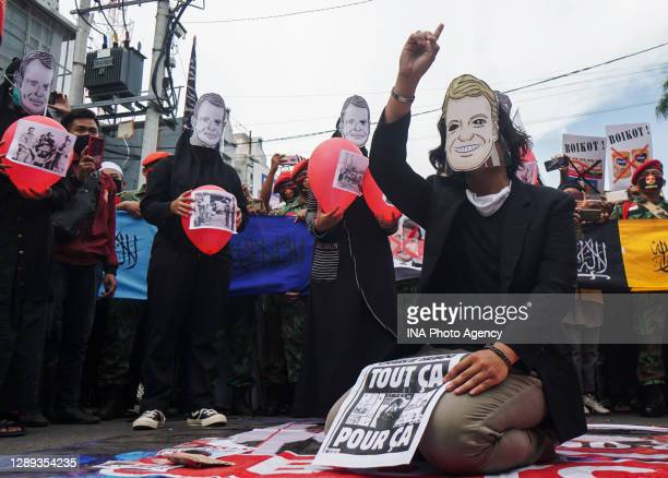 Muslim protesters take part a protest against French President Emmanuel Macron outside the France Consulate in Surabaya, East Java, on November 2,...