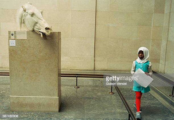 A Muslim pupil at from Millfields Community School views the Parthenon Selene Horse during a school trip to the British Museum This sculpture is part...