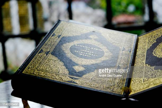 muslim quran book on a stand - allah photos et images de collection