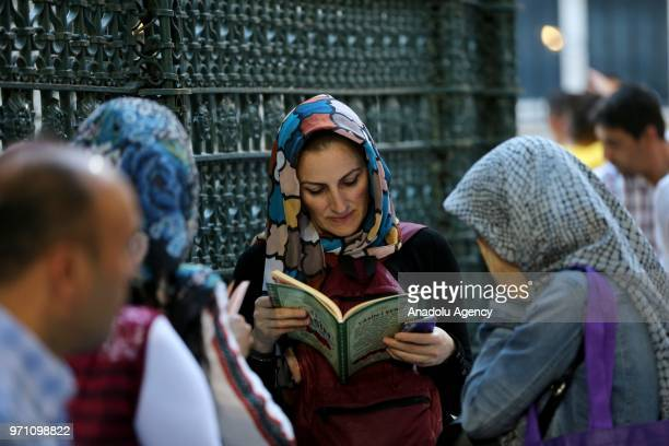 A muslim reads Quran on the Laylat alQadr at Eyup Sultan Mosque in Istanbul Turkey on June 10 2018