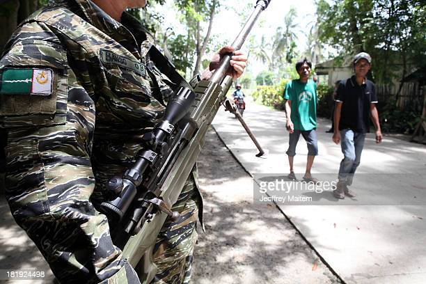 Muslim rebel stands at a checkpoint inside the village they control on September 26 2013 in Sultan Kudarat Maguindanao Philippines The Moro Islamic...