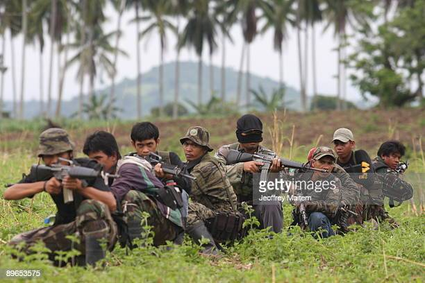 Muslim rebels belonging to the Moro Islamic Liberation Front , the country's largest rebel group take part in a combat drill on July 30, 2009 in the...