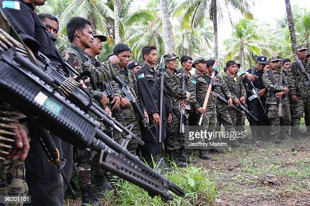Muslim rebels from the Moro Islamic Liberation Front gather in the Southern Philippine town of Mamasapano in Maguindanao as peace talks are resumed...