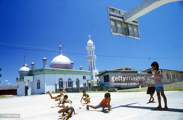 Muslim rebels in Jolo and Zamboanga In PhilippinesChildren dancing hiphop in front of mosque Zamboanga