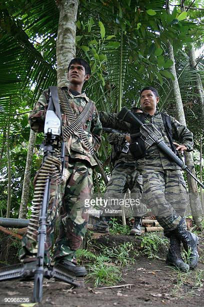 Muslim rebels secure the vicinity of their camp after Ibrahim Murad, chief of the Moro Islamic Liberation Front, warns anarchy if peace talks between...