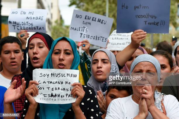 Muslim resident of Barcelona hold messages reading 'I am a muslim Catalan i am not a terrorist Islam is peace' or 'We are also afraid' as they...
