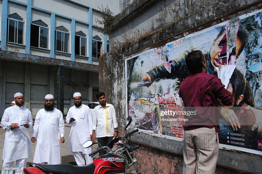 Muslim residents of Mumbra tearing the Poster of of Kamal Hassan's film Vishwaroopam during its screening at local Alishan theater on February 1, 2013 in Mumbai, India. 'Vishwaroopam' released all over India amid security except Tamil Nadu where it was banned after some Muslim groups taken objection to certain scenes in the movie as hurting their religious sentiments.