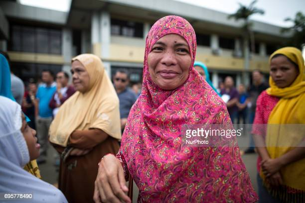 Muslim residents smile before a symbolic flag raising ceremony in celebration of the Independence Day in Marawi City Philippines on June 12 2017 As...
