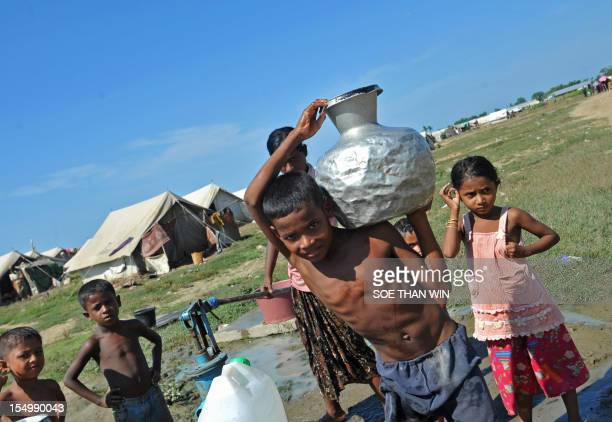 Muslim Rohingya boy carries a water pot inside the Bawdupha camp clinic at the Bawdupha Internally Displaced Persons camp located on the outskirts of...