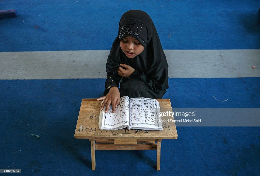 Muslim Rohingya children read the Koran inside the Madrasah (Religious School) during the holy month of Ramadan on June 9, 2016 in Klang outside Kuala Lumpur, Malaysia. Muslims around the world including Indonesia, Thailand and Arab state are observing the fasting month of Ramadan, Islam's holiest month, during which observant believers fast from dawn to dusk. They celebrate the end of the Ramadan with Eid al-Fitr festival.