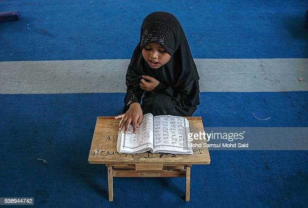 Muslim Rohingya children read the Koran inside the Madrasah during the holy month of Ramadan on June 9 2016 in Klang outside Kuala Lumpur Malaysia...
