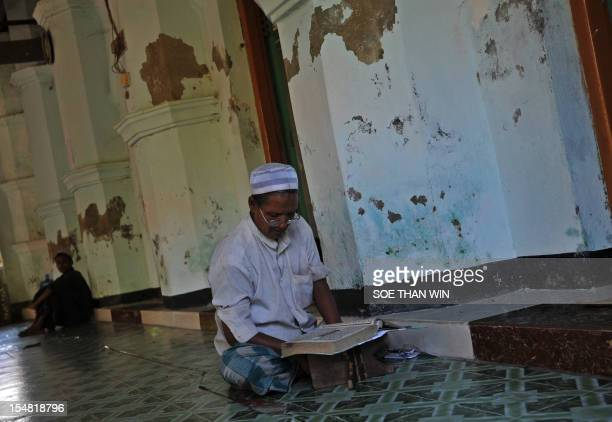 Muslim Rohingya man prays at a mosque in Aung Mingalar quarter in Sittwe, capital of western Rakhine state on October 27, 2012. Seething resentment...