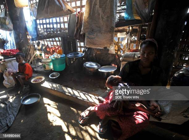 Muslim Rohingya people sit on the floor inside the Bawdupha Internally Displaced Persons camp located on the outskirts of Sittwe, capital of...