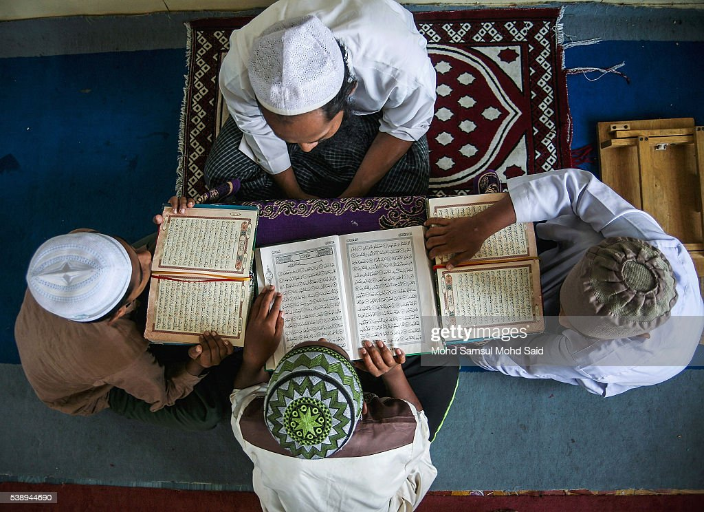 Muslim Rohingya refugees read the Koran inside the Madrasah (Religious School) during the holy month of Ramadan on June 9, 2016 in Klang outside Kuala Lumpur, Malaysia. Muslims around the world including Indonesia, Thailand and Arab state are observing the fasting month of Ramadan, Islam's holiest month, during which observant believers fast from dawn to dusk. They celebrate the end of the Ramadan with Eid al-Fitr festival.