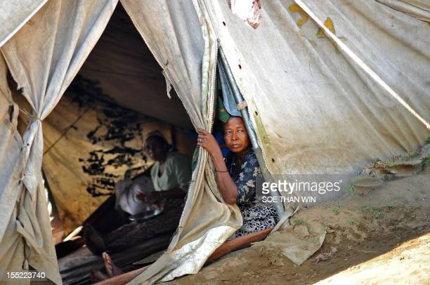 Muslim Rohingya women sit inside a tent in the Bawdupha Internally Displaced Persons camp on the outskirts of Sittwe, the capital of Myanmar's...