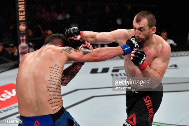 Muslim Salikhov of Russia and Laureano Staropoli of Argentina exchange punches in their welterweight bout during the UFC Fight Night event at...