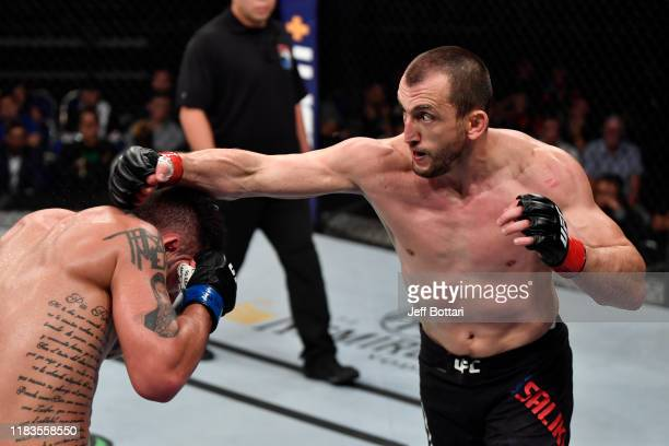Muslim Salikhov of Russia punches Laureano Staropoli of Argentina in their welterweight bout during the UFC Fight Night event at Singapore Indoor...