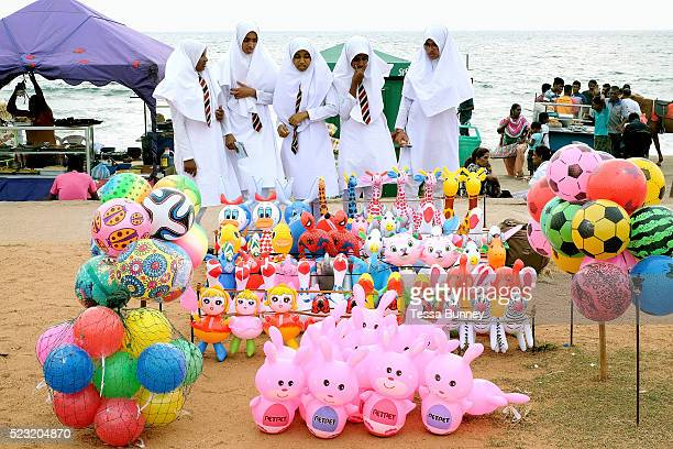 Muslim school girls look at the brightly coloured inflatable toys on Friday 8th April at Galle Face Green in Colombo Sri Lanka Galle Face Green is a...