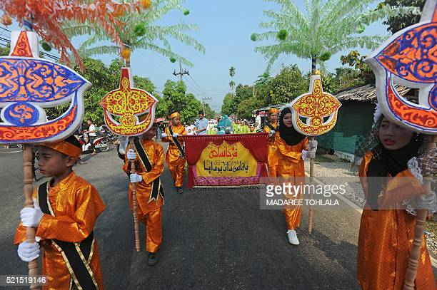 Muslim schoolchildren participate in the opening parade of the Kadrika Sampan festival in Rangae district in Thailand's restive southern province of...