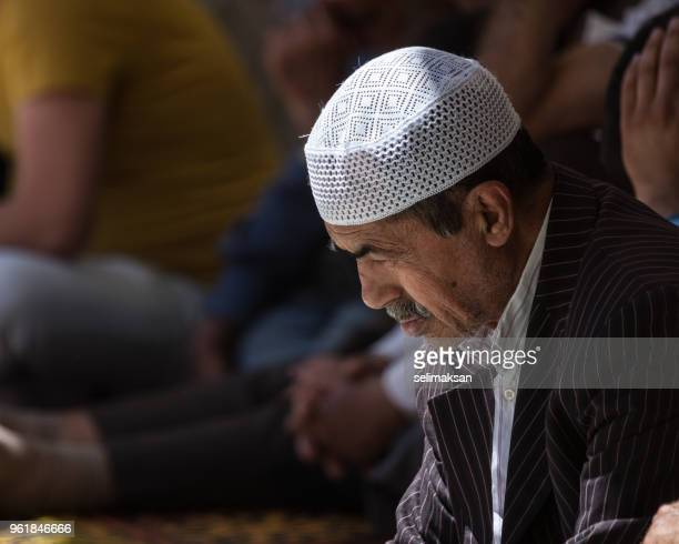 Muslim Senior Muslim Man Wearing Skull Cap Praying In Mosque
