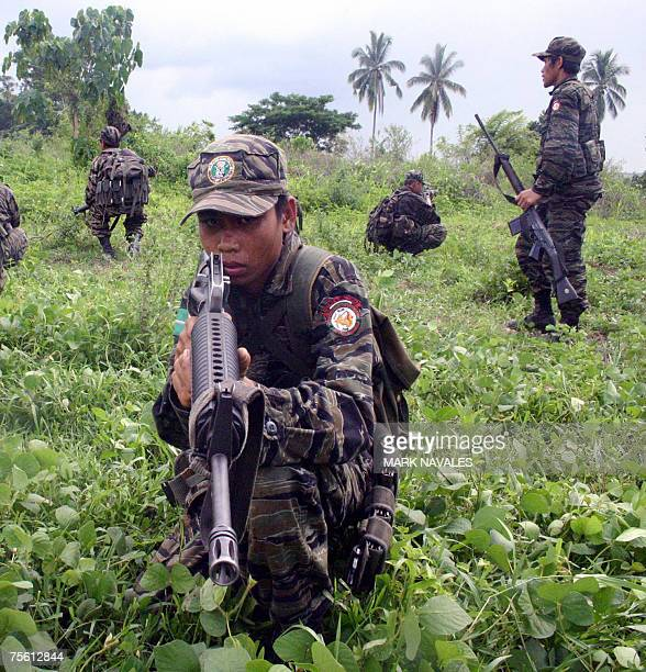 Muslim separatist rebels from the Moro Islamic Liberation Front conduct combat exercise at a guerrilla camp in Shariff Kabunsuan province in southern...
