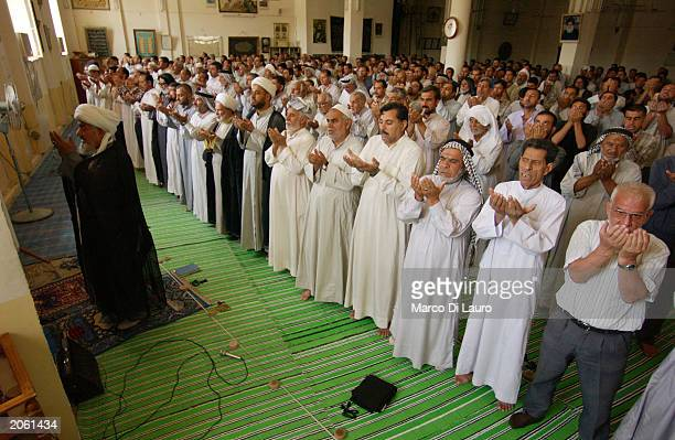 Muslim Shias pray during Friday prayer in a mosque June 6 2003 in Saddam City Baghdad
