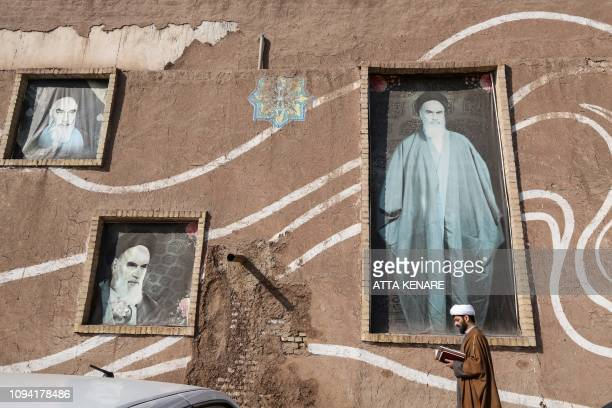 A Muslim Shiite cleric walks past the house of the late founder of the Islamic Republic Ayatollah Ruhollah Khomeini in the holy city of Qom 130...