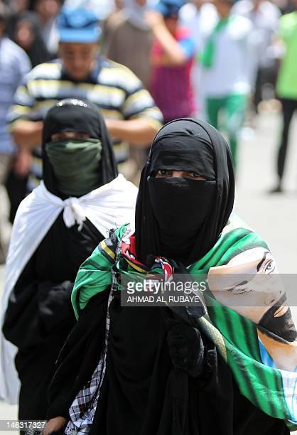 Muslim Shiite pilgrims head on foot to the Kadhimiya shrine in north Baghdad to commemorate the death anniversary of Imam Musa Kadhim the seventh of...