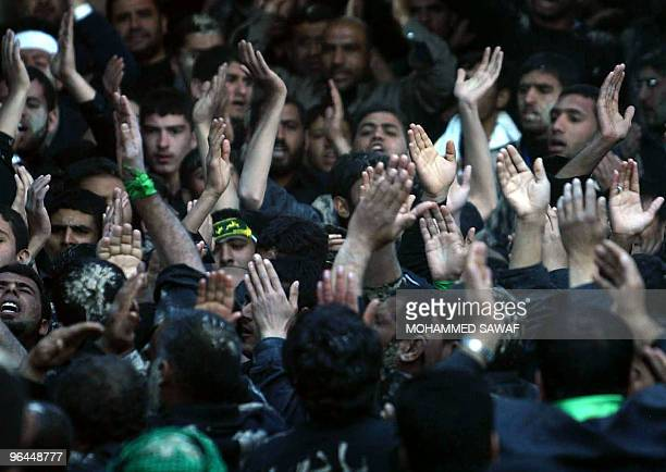 Muslim Shiite pilgrims perform a ritual as they mark the Shiite mourning day of Arbaeen in the Iraqi holy city of Karbala, 110 kms south of Baghdad,...