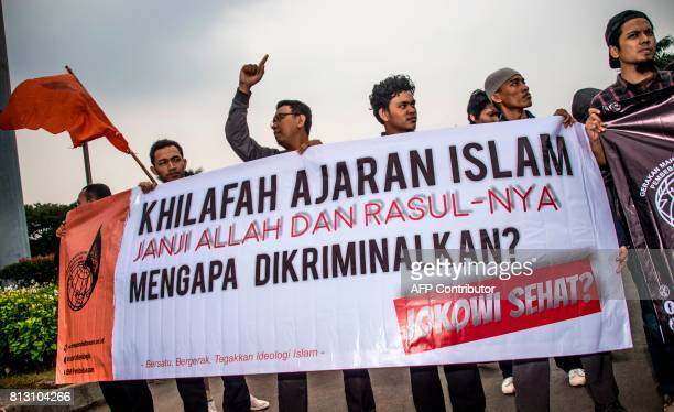 Muslim student activists take part in an anti-government rally in Jakarta on July 12 after President Joko Widodo signed a new law to disband Hizb...