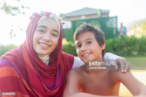 Muslim teenage girl with her brother on vacation