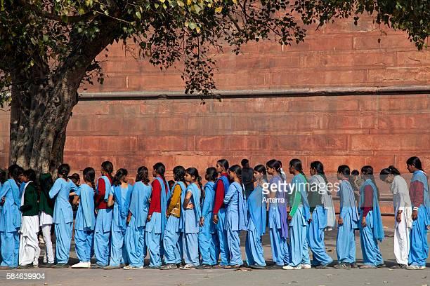 Muslim teenager girls wearing blue school uniforms in Old Delhi India