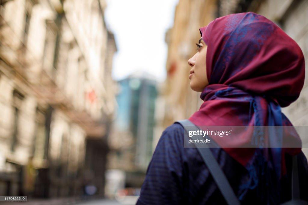 Muslim tourist exploring city : Stock Photo