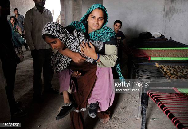 Muslim villagers who have taken shelter at Islam Nagar in Shahpur area during communal violence on September 10 2013 in Muzaffarnagar India No...