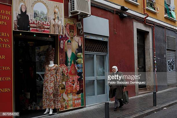 Muslim walks pass a Muslim clothes shop on January 30 2015 in Madrid Spain More than 17 million Muslims live in Spain which is around the 36 percent...
