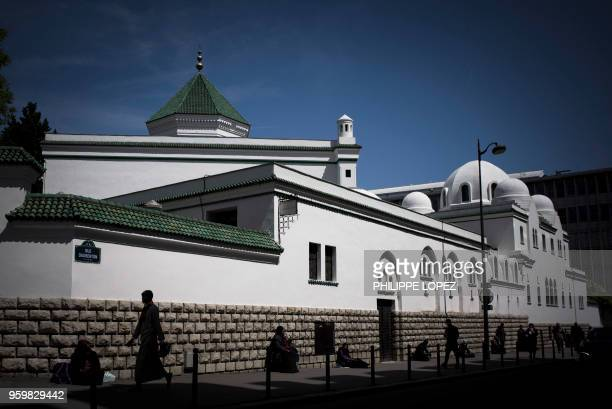 A Muslim walks toward the Grande Mosquee de Paris in Paris on May 18 2018 for the first Friday prayers of the holy month of Ramadan