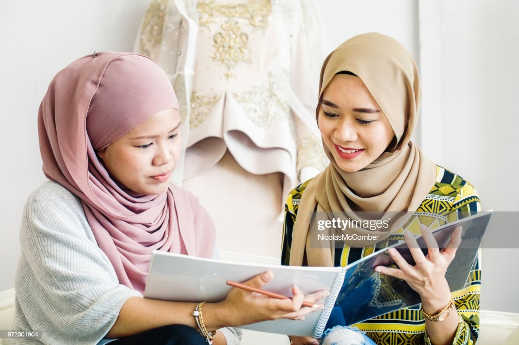 Muslim Wedding Dress Designer Showing Collection Catalog To Customer High Res Stock Photo Getty Images,Davids Bridal Curvy Flattering Plus Size Wedding Dresses