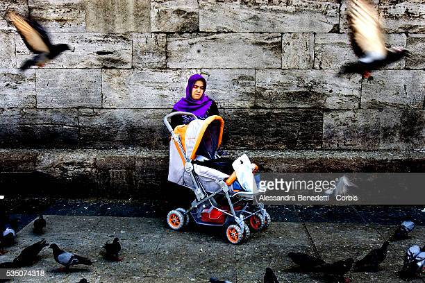 A Muslim woman and her child outside a mosque in Istanbul